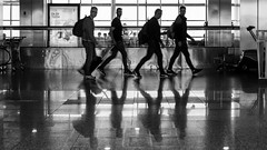 scene at the airport / quick feet (Özgür Gürgey) Tags: 2017 50mm airport atatürkairport bw d750 nikon blur candid motion people reflection istanbul turkey 169