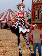 Clown2 (iggy62pop2) Tags: giantess shrinkingman sexy tallwoman funny female clown minigiantess milf upskirt stockings circus heightcomparison