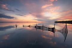 Sunset entrapment (Stephen Hunt61) Tags: net sunset sea seascape reflections nature lagoon clouds sky horizon water fishing tramonto laguna scenery paesaggio rete acqua mare riflessi stefanocaccia