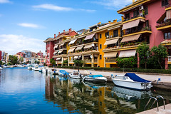 Colorful City (WhiteShipDesign) Tags: tourism water colorful architecture travel europe boat summer building beautiful sky european cityscape color city mediterranean town vivid harbor houses vacation colorfulhouses boats scenic urban leisure destination