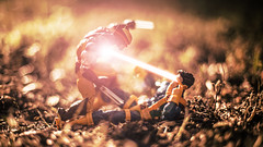 Dispute (3rd-Rate Photography) Tags: xmen cyclops wolverine beam logan scottsummers battle marvel marvellegends toy toyphotography canon 50mm 5dmarkiii jacksonville florida 3rdratephotography earlware actionfigure