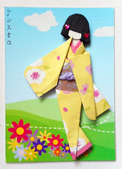 ATC1342 - On a clear day (tengds) Tags: japanesepaperdoll origamidoll ningyo handmadedoll kimono pink flowers obi purple atc artisttradingcard artcard handmadecard card japanesepaper origamipaper yuzenwashi washi chiyogami collage blue bluesky clouds whiteclouds red green grass nailartembellishment papercraft tengds yellow
