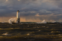 Rain King (Aaron Springer) Tags: michigan northernmichigan lakemichigan thegreatlakes frankfortlighthouse breakingwave water pier breakwater lighthouse stormlight outdoor nature landscape