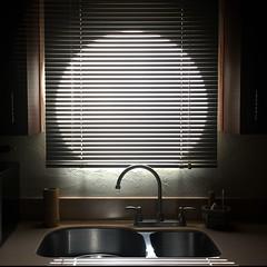 Morning Light from the Kitchen Window (buddhadog) Tags: morninglight kitchenwindow circularwindow sink venetianblinds 500x500 100vu 500vu challengeyouwinner ruby3 g2haiku mm108 20faves ruby10 2wins 1250
