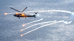 Sea Hawk with Flares (sjrankin) Tags: review 27april2017 edited usn unitedstatesnavy helicopter 170424nbl637072 seahawk bluehawks mh60r flares