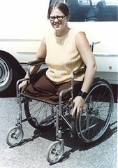 0102pf07 - DAK Paula on Wheels (jackcast2015) Tags: amputee legamputee wheelchairwoman wheelchair disabledwoman crippledwoman amputeewoman nolegs doubleabovekneeamputee dakamputee glasses eyeglasses girlswithglasses girlswearingglasses
