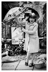 Brolly good forties fun (A.I.D.A.N.) Tags: umbrella brolly lady woman hat coat 1940s 40s forties blackwhite blackandwhite basket signs wartime poster ontovictory victory museum aircrewswanted canon canon5dmarkii canon5dmkii canoneos5dmarkii mkii markii monochrome vintage 1940skneesup oldfashioned playacting pose portrait fun humorous photoborder wwii worldwartwo ww2 newspaper rations outside portraits person