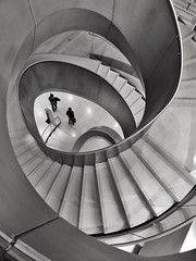 Opprobrium (Douguerreotype) Tags: uk gb britain british england london city urban architecture stairs steps staircase helix spiral people bw blackandwhite mono monochrome 2 two