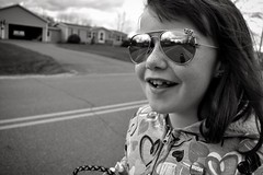 Dog walker (triciaamore) Tags: grayscale monochromatic monochrome blackandwhite dogwalker walker walking happy portrait street reflection dog sunglasses daughter kid child girl project365 365project