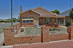 Brick Veneer Home - Donald (IDH Mackinnon) Tags: donald victoria victorian australia australian aussie id hearn photographer photos photograph image picture brick veneer verandah cream home house building architecture architectural historic historical 1960s modern country rural town