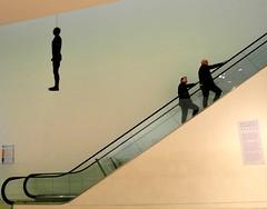 Hanging around... (Peter Denton) Tags: npg nationalportraitgallery london object antonygormley sculpture castiron art ondaatjewing ©peterdenton escalator male samsungwb750 escalier artgallery museum