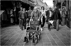 Disability Doesn't Mean Inability (Steve Lundqvist) Tags: candid shot old man poor walking elderly aged age people patology disease syndrome handicap malato malattia patologia back artrite hat bechterew arthritis spondylitis ankylosing rheumatoid rheumatism vecchio vecchiaia teramo italy italia italiano povertà poverty bw blackandwhite monochrome street fujifilm abruzzo wheelchair disability inability streetphotography
