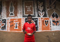 Young man painting the wall of a traditional ethiopian house, Kembata, Alaba Kuito, Ethiopia (Eric Lafforgue) Tags: abyssinia adolescent africa african alaba architecture art artist building color culture day decorated decoration depiction eastafrica ethiopia ethiopian ethnic geometric home horizontal hornofafrica house housing hut illustration kulito lookingatcamera mural naive oneperson outdoors painted painter painting people poverty skill teenager toukoul tukul village waistup work working youngadult ethio163442 alabakuito kembata