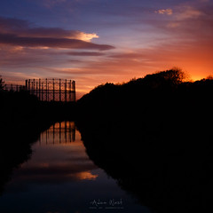 A Light Still Burns (Adam West Photography) Tags: adamwest canal clouds clyde forth gas gasholders gasometer glasgow glow heritage industrial orange reflections scotland silhouette sky sunset temple tower uk water