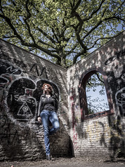Hanneke, Amsterdam 2017: Folly (mdiepraam) Tags: hanneke amsterdam frankendael 2017 portrait dutch pretty attractive gorgeous beautiful elegant classy mature fiftysomething woman redhead curls naturalglamour lady girl milf jeans denim leatherjacket graffiti tree architecture building folly