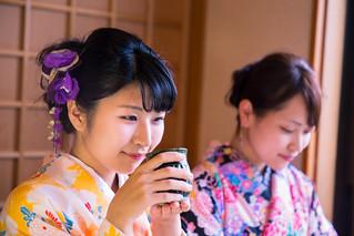 Young women in kimono on tea break at restaurant