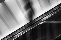 the man who was there not to be seen / one escalator fun coming your way (Özgür Gürgey) Tags: 2017 50mm bw d750 nikon nispetiye blur dlagonal escalator lines motion shadow station subway trails istanbul turkey