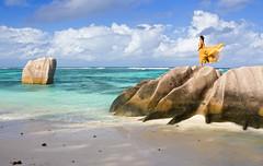 LaDigueRocks (Rita Eberle-Wessner) Tags: seychelles seychellen ansesourcedargent ladigue strand beach rocks woman frau lady yellowdress wind breeze meer ocean indianocean island water wasser insel wolken clouds