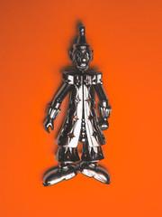 Tears of a Clown (Steve Taylor (Photography)) Tags: tearsofaclown clown silver art digital orange metal newzealand nz southisland canterbury christchurch northnewbrighton shiny shadow tears costume jewelry smokeyrobinsonthemiracles