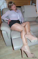 Sofa loafer (janegeetgirl2) Tags: transvestite crossdresser crossdressing tgirl tv ts stockings heels gloss shine tights hosiery nylons glamour stilettos mini skirt lilac chiffon blouse jane gee office secretary nude legs thighs cross crossed