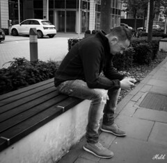 Project 365; #118 (iMalik1) Tags: project 365 days photo day challenge potd street photography person sitting alone phone thinking black white bnw bw walking home ealing after work broadway get west london snapped make it canon eos m3 efm 22mm imalik photographer