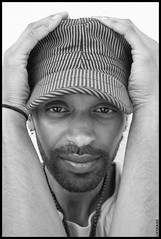 Hold On (LiesBaas) Tags: explore photography zw bw man rakesh portrait portret canon hat holdonbyliesbaas