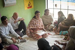 UNICEF Regional Director for South Asia Daniel Toole and other UNICEF staff meets with a mothers group at a centre for Anganwadi Workers (AWW) in the village of Pakbara in Tajpur block... (unicefindia) Tags: communitymeeting grouppeople india men ngo polio women