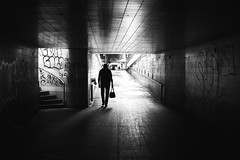 By the big exit (pascalcolin1) Tags: paris13 homme man tunnel chanel lumière light ombre shadow porte door photoderue streetview urbanarte noiretblanc blackandwhite photopascalcolin