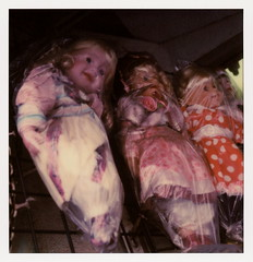 Wrapped In Plastic 10 (tobysx70) Tags: the impossible project tip polaroid slr680 frankenroid sx70 door rollers color film for 600 type cameras impossaroid wrapped in plastic hugables winstron street dlta downtown los angeles la california ca doll creepy scary hanging bag toy shop store toby hancock photography