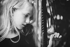 Just living is not enough... one must have sunshine, freedom, and a little flower... (marina_ta) Tags: kid bw portrait cute dreaming moody flower blackandwhite
