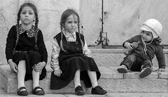 Little House on the Prairie (ybiberman) Tags: israel jerusalem meahshearim passover children girls people braids stairs boy bottle bw candid streetphotography