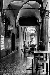 Coffee break.... (Lupogrande25) Tags: bologna italy break coffee shadows blackandwhite canonpowershots90 chairs table people street