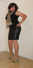 wearing my leather look skirt with tan stockings, cougar pumps and scarf (Barb78ara) Tags: leatherlook leatherlookskirt wetlook wetlookskirt blackskirt miniskirt turtlenecktop blacktop scarf animalprint animalprintpumps animalprintscarf stilettoheels highheels tannylon tanstockings stockings