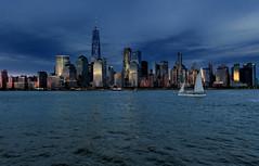 Lower Manhattan (R.o.b.e.r.t.o.) Tags: newyorkcity downtownmanhattan usa orablu bluehour tramonto sunset grattaceli skyscrapers mare sea cielo sky hudson fiume river sailboat barcaavela unitedstatesofamerica