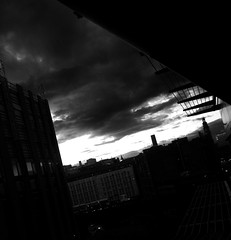 flying low (vfrgk) Tags: cityscape cityview citylife urbanphotography urbanfragment monochrome blackandwhite bw buildings cloudy cloudscape lastlight darkmood urbanlife sky