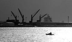 Calm before the storm (OzzRod) Tags: pentax k3 smcpentaxda55300mmf458 harbour port silhouette kayak cranes wharf monochrome blackandwhite intothesun newcastle