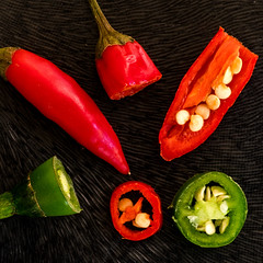 Chilli bits (OzzRod) Tags: pentax k1 smcpentaxdfa100mmf28macroltd 52project2017macroedition lightbox anatomy macro plant chilli pepper seed red green square