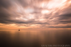 view from Seaton Sluice (sidrog28) Tags: sky dawn clouds sun sea sunny long exposure boats boat nikon photography photo