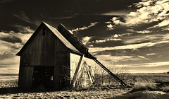 conveyance... (BillsExplorations) Tags: conveyance corncrib elevator barn farm abandoned abandonedillinois abandonedfarm sepia old sky clouds windfarm agriculture lee forgotten decay ruraldecay vintage farmmachinery relic