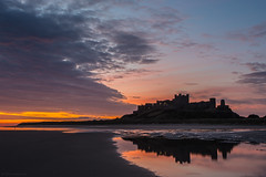 Daybreak over Bamburgh (andyrousephotography) Tags: bamburgh castle northumberland beach sand sea pools reflections sun sunrise early morning clouds colours blues pinks oranges reds redoctober andyrouse canon eos 5d mkiii