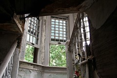 Beautiful windows in the staircase landing. (seventh_sense) Tags: abandoned ruins decay house deserted home homestead porch overgrown field overgrowth brambles weathered derelict decayed decaying rotting fire damage damaged destroyed burned charred collapse collapsed collapsing victorian garrison owings mills maryland firedamaged
