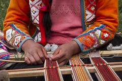 Skilled hands (Leaning Ladder) Tags: peru cuzco pisac awanakancha camelid farm alpaca sacredvalley native weaving wool hands colors orange leaningladder canon 7d