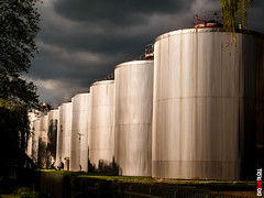 Two Pints of Lager (BigRedTroll) Tags: architecture blue brewery building cloud color golden goldenhour industrial industriallandscape leadinglines moody people sky stormy structure tank texture tower