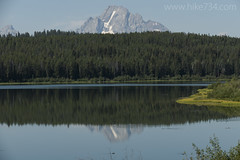 """Mt. Moran reflecting in Two Ocean Lake • <a style=""""font-size:0.8em;"""" href=""""http://www.flickr.com/photos/63501323@N07/34348449425/"""" target=""""_blank"""">View on Flickr</a>"""