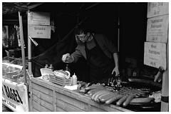The finishing touch (jas.mann-real life photos-no photoshopping) Tags: piss pee husband boyfriend food camden london stall hotdog digital camera fujifilm sausage squirting