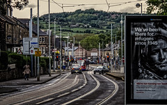 Tram in traffic -2 (Peter Leigh50) Tags: sheffield supertram tram traffic car road street pole hill hillside urban city cityscape scene