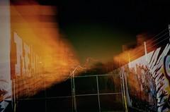 Gate (tylersullivan618) Tags: abandoned abandonedporn graffiti abandonedillinois abandonedchicago experimental lomo lofi elomography lomography tylersullivan tylersullivanphotography building streetphotography streetart streets mega mall megamall urban urbandecay urbanexploration urbex decay desolate decaynation decaying grime art movement exposure explore exploration chicago logansquare orange color colorful vibrant