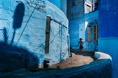 Blue. Jodhpur, India (Marji Lang Photography) Tags: 2013 canon5dmii inde india indiansubcontinent jodhpur marjilang rajasthan travelphotography blue bluecity bluestreet city colors composition documentary girl horizontal indian moment oldjodhpur people photography photojournalism rajasthani running spontaneous street streetphotography streetshot travel