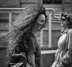 Wild hair- (Nikonsnapper) Tags: olympus omd em1 zuiko 75 mm street curly long hair windy monochrome candid waits