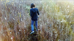 Young man, searching for his path... (TravelsWithDan) Tags: youngman teen field grasses weeds midwest michigan ada candid